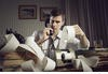stock-photo-an-male-accountant-at-telephone-preparing-income-taxes-135615605