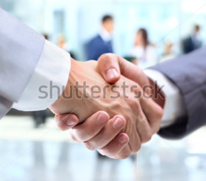 stock-photo-business-handshake-and-business-people-108327197