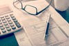 stock-photo-individual-income-tax-return-form-glasses-pen-and-calculator-on-desk-264409757